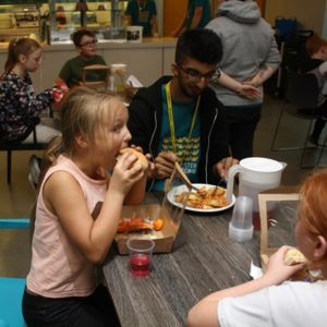 Young people enjoying hot meal at Holiday Club