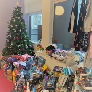 donated presents under the christmas tree